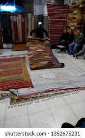 FES, MOROCCO - FEB 13, 2019 - Showing carpets in a shop in the medina of Fes, Morocco, Africa