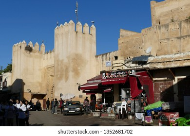 FES, MOROCCO - FEB 13, 2019 - Traffic at the fortified gate in walls in the Jewish quarter, Fes, Morocco, Africa