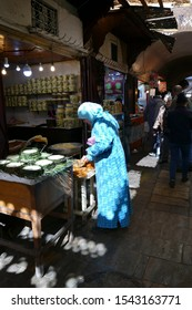 FES, MOROCCO - FEB 13, 2019 - Woman shopping in the medina of Fes, Morocco, Africa