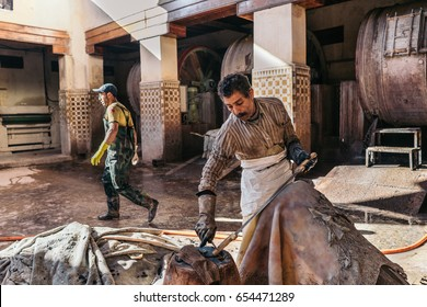 FES, MOROCCO - JANUARY 8, 2017: People working in the Chouara Tannery. This tannery dates from 11th century.