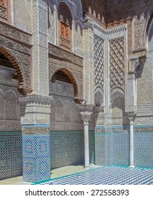 Fes, Morocco - May 11, 2013: Moroccan Carved Plaster Arabesque and mosaic in the 14th century  El Attarine Medersa in Fez, Morocco