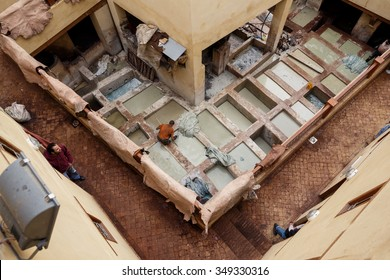 FES, MOROCCO - NOVEMBER 1, 2015: People working at famous Chouara Tannery in Fes Medina, Morocco