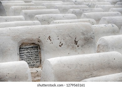 FES, MOROCCO - OCTOBER 19, 2018: The Jewish cemetery in Fes, Morocco is filled with ranks of white tombs.