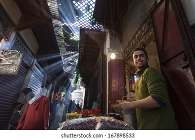 FES - NOVEMBER 24: Unknown man trades fruits in a Market (souk) in a city Fes in Morocco. The market is one of the most important attractions of the city. November 24, 2013 Fes, Morocco