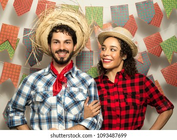 Festa Junina: party in Brazil in the month of june. Man and woman dressing checked pattern clothes. Man and woman dressing checked pattern clothes posing to the photo.
