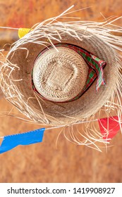 Festa Junina, Sao Joao, with Party small colorful Flags and decorative balloon it happens in June, mostly in Northeast of Brazil. Straw hat is a symbol of the festival.