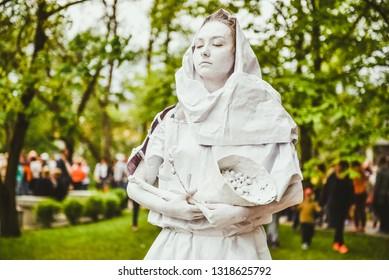 "Festival of the city Rezekne ""Seven Hills"", performance of live sculptures. Live angel sculpture. Rezekne - Latvia, 27 may, 2017"