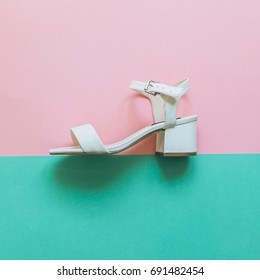 festival concept for fashion women:  white patent leather sandals with wide heel.