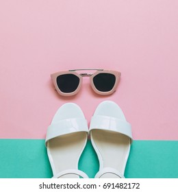 festival summer set: stylish pink sunglasses and white sandals. minimal fashion trend