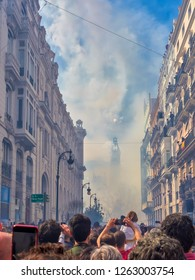Festivals of the Fallas of Valencia. Crowd of people observe in the Town Hall Square, the Mascletás, where thousands of firecrackers, pyrotechnic elements and colored smoke are thrown.