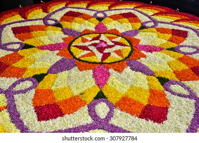 Festivals of Kerala: Onam. Overhead view of a Floral carpet (athappookkalam, rangoli), the hallmark of Onam, the national festival of Malayalees, irrespective of religion, caste or creed.