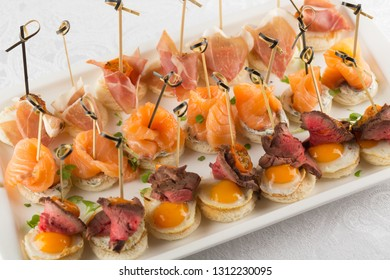 Festive Appetizer with quail egg, salmon and roast beef