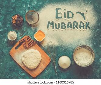 "Festive Arabic background. Eid Mubarak - Islamic holiday welcome phrase "" happy holiday"", greeting reserved."