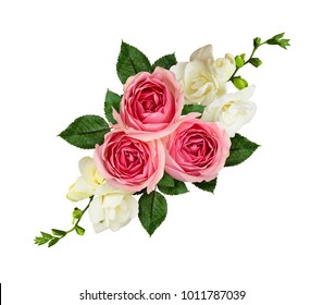 Festive arrangement with pink roses and freesia flowers isolated on white. Top view. Flat lay.