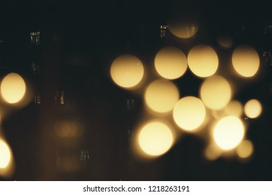 Festive asbtract golden lights with bokeh on black background