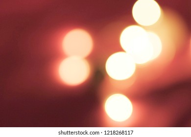 Festive asbtract red and golden lights with bokeh on dark background