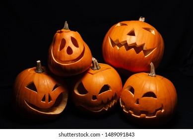 festive autumn card with orange pumpkins. Jack's lantern on Halloween celebration on black background
