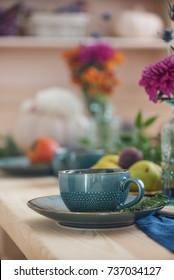festive autumn table, autumn food and paraphernalia, pumpkins, flowers, tea
