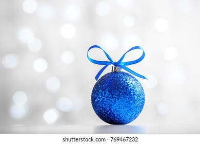 Festive background with a blue ball. The concept of Christmas and New Year.