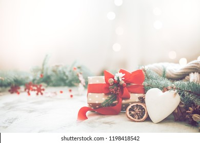 Festive background with a heart and a gift with a red bow on a light background, the concept of Christmas and the holiday