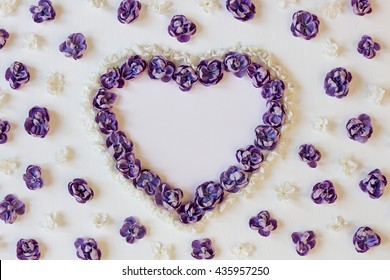 Festive background with hearts of flowers. Valentine day background. Frame of flowers of lilac. The top view. Flat lay.