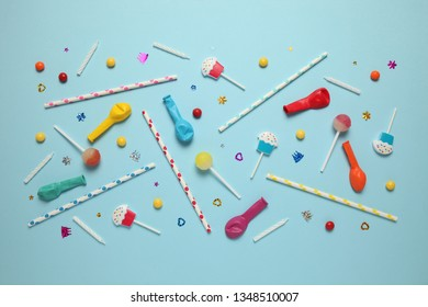 Festive background (pattern) of children's holiday. Cheerful birthday party with sweets on blue background.