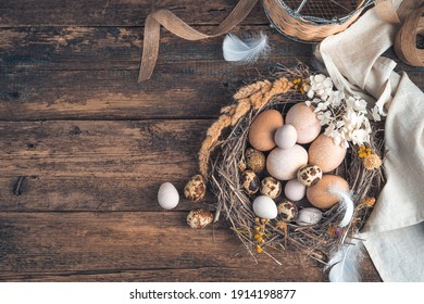 Festive background with quail and chicken eggs on a wooden background. Top view, horizontal. The concept of Easter.