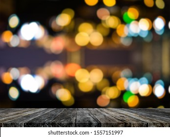Festive background with Rainbow light effects and empty wooden table for Party decoration.Empty wooden table with party in Rainbow light effects background blurred.