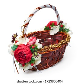 Festive basket with a flower arrangement on white background