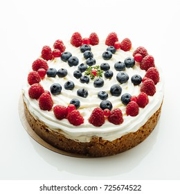 festive berries cake, white background