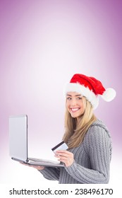 Festive blonde shopping online with laptop on vignette background