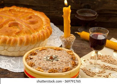 Festive bread with wheat on rustic table