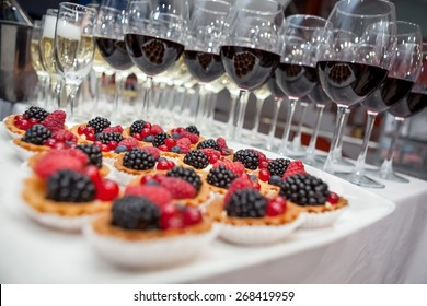 Festive buffet at the event with desert, champagne and wine. Soft focus