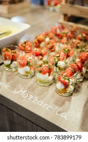 festive buffet with mozzarella and tomatoes in a glass