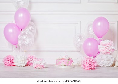 Festive cake and balloons. White and pink color. Birthday or wedding party