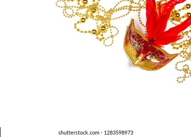 Festive Carnival background with red mask, beads and copy space. Carnivale mask on white background.