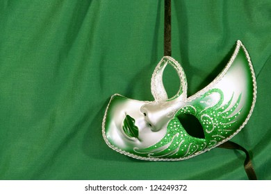 Festive carnival mask on the background of green cloth