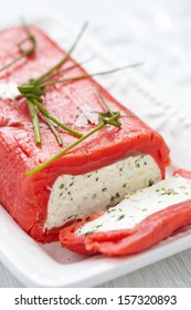 Festive cheese terrine wrapped with smoked red salmon