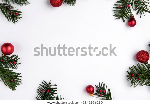 Festive Christmas background with beautiful decorations and pine branches on white backgorund