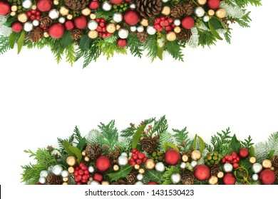 Festive Christmas background border with red, silver and gold bauble decorations and winter flora with pine cones on white with copy space.