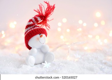 Festive Christmas background with snowman on the snow