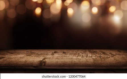 Festive christmas bokeh background and empty rustic wooden table for a decoration