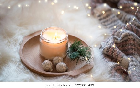 Festive Christmas candle , holiday winter decoration candlelight with sparkle lights