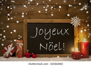 Festive Christmas Card With Chalkboard, Red Gifts, Christmas Balls, Snowflakes And Candles. Christmas Decoration With Vintage Wooden Background. FrenchText Joyeux Noel Mean Merry Christmas