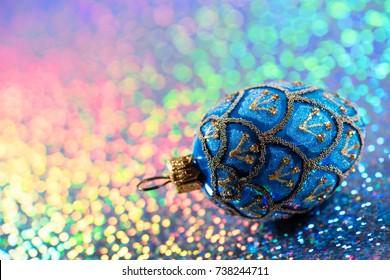 Festive Christmas decoration on rainbow glitter background