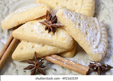 Festive Christmas holiday traditional shortbread biscuit cookies on a rustic wood table background.