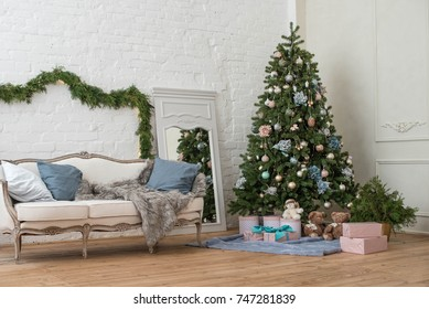 a festive Christmas interior in white with a Christmas tree and Christmas hares