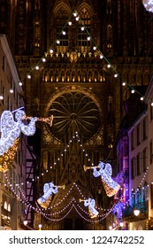 Festive Christmas lights and decorations with blurred background in front of Chathedrale Notre Dame at Rue Merciere in Strasbourg - Capital of Christmas, Alsace, France