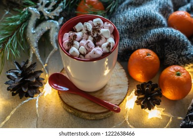 Festive Christmas or New Year composition with cup of hot chocolate, marshmallows and tangerines close up.