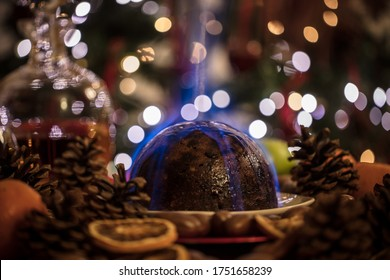 festive christmas pudding on fire in a traditional setting